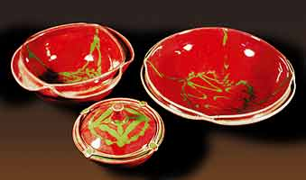 Three copper red bowls