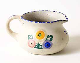White jug with floral design