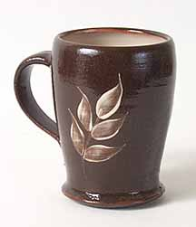 Brown beaker with leaf design