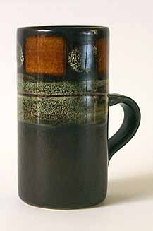 Tall cylindrical Celtic mug