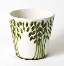 White Poole pot with green design