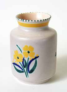Pale grey Poole pot with yellow flowers