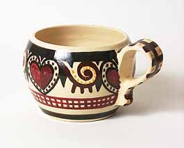 Quimper cup with heart design