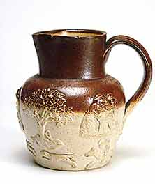 Sprig decorated stoneware jug