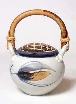Lidded jar with cane handle