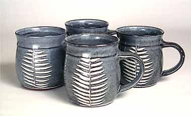 John Solly mugs