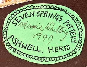 Seven Springs gardener (label)