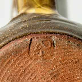 Brown Aylesford slipware jug (mark)