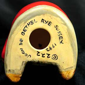 Red blazer De Bethel bear (marks)