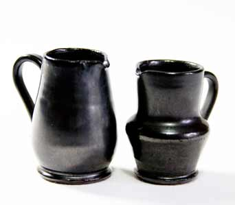 Two Merlin miniature jugs